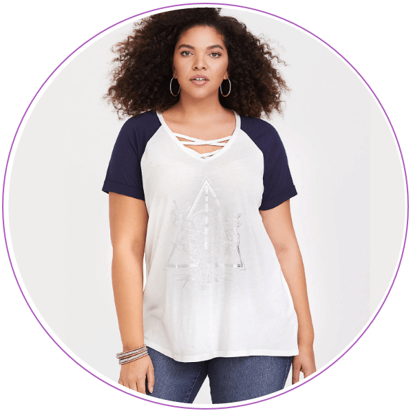 Woman wearing white t-shirt with Deathly Hallows symbol