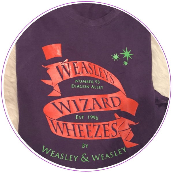Purple and orange Weasley Wizard Wheezes logo