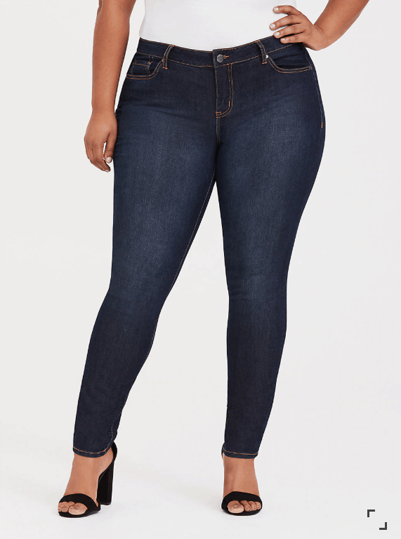 Woman wearing dark wash tight jeans