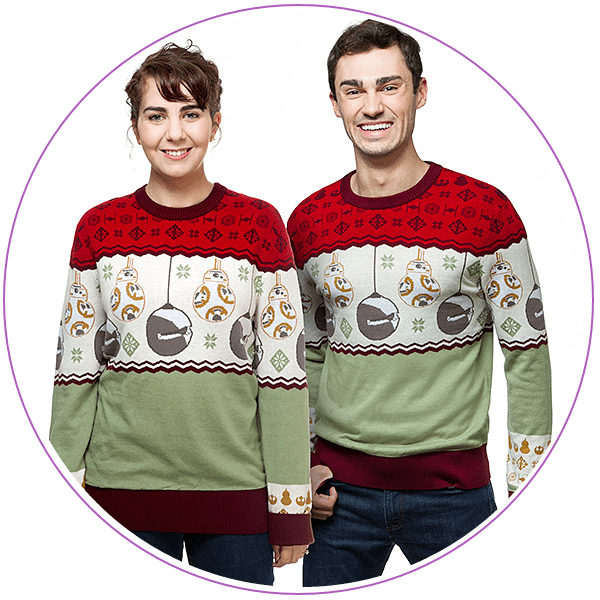Woman and man wearing Christmas sweaters with BB-8