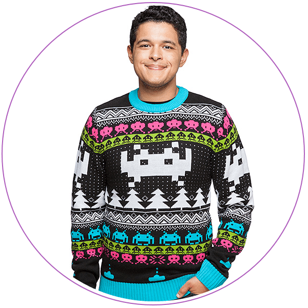 Man wearing an ugly Christmas sweater of Space Invaders