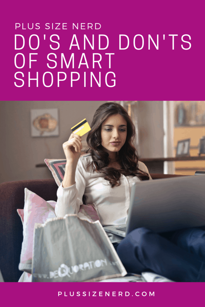 Woman holding a credit card and shopping on her computer