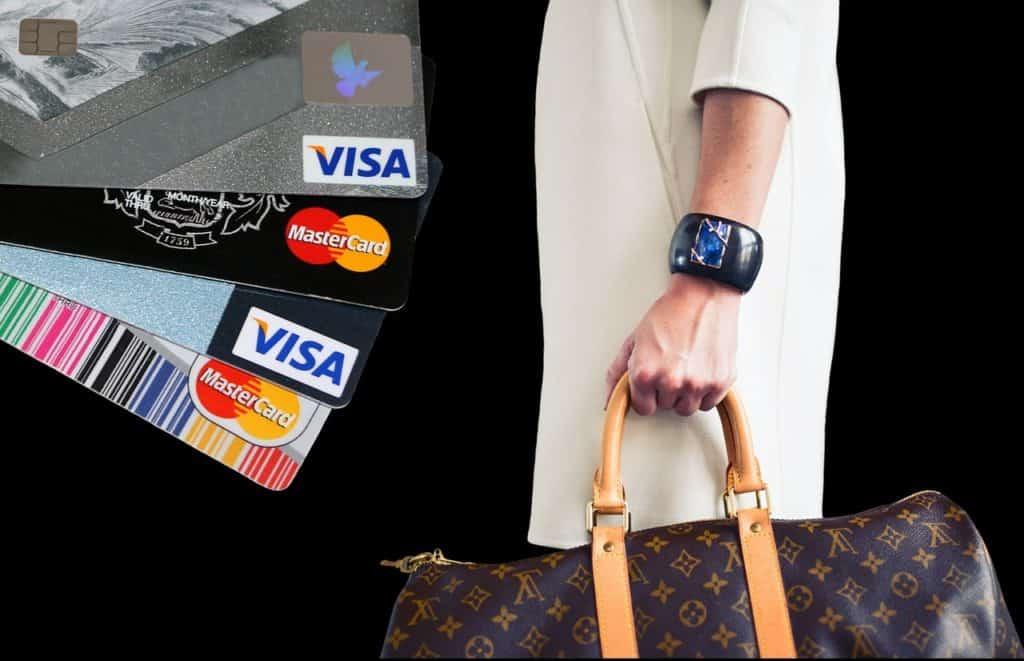 Credit cards and woman carrying handbag